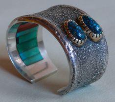 ~  Hopi tufa-cast silver inlaid cuff  bracelet by Charles Loloma, circa 1974-1977