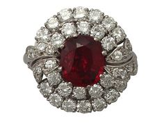 'Vintage Cushion Cut Ruby Ring' http://www.acsilver.co.uk/shop/pc/2-82-ct-Ruby-and-2-48-ct-Diamond-Platinum-Cluster-Ring-Vintage-Circa-1950-35p9459.htm