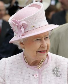 Queen Elizabeth, love this tear drop shape hat with the rounded center on her!