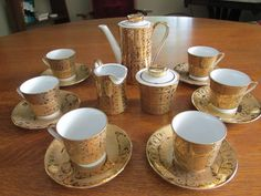 Vintage, china, Bavarian tea set with 6 demitasse cups, saucers, tea pot, creamer, sugar and 4 gold colored spoons. $45