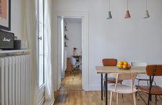 Quand Marion acquiert cette surface de 44 m² près de la Porte Saint Denis c'est à son amie et architecte Céline Hervé qu'elle confie la réalisation de son premier appartement.L'endroit présente deux intérêts : la circulation s'y fait autour d'un axe central, pratique ! et il est bordé par un balcon filant typiquement parisien dont la vue donne sur les toits. En plus d'une rénovation en bonne et du forme, l'objectif de l'architecte a donc été de repenser la cuisine comme une pièce de passage… Decor, Table, Inspiration, Room Divider, Furniture, Home Decor, Room