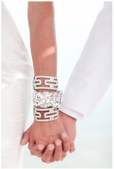 Glam layered wedding jewelry. From Style Me Pretty.