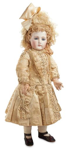 """*AN EXTRAORDINARY FRENCH BISQUE PORTRAIT BEBE IN ORIGINAL COUTURIER COSTUME  ` 26"""" T. Pressed bisque socket head w/long-faced modeling + full cheeks, almond-shaped blue/grey enamel inset eyes... MARKS: 12 (head) Jumeau Medaille diOr Paris (body).   COMMENTS: Emile Jumeau, c.1878"""