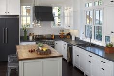 black counters, white cupboards