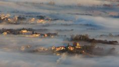 Morning Fog in Italy - Morning light with fog through Vipava valley covering also Savogna d'Isonzo, Rupa and Peci villages in Italy. Savogna d'Isonzo (Slovene: Sovodnje ob Soči) is a comune (municipality) in the Province of Gorizia in the Italian region Friuli-Venezia Giulia, located about 35 kilometres (22 mi) northwest of Trieste and about 3 kilometres (1.9 mi) southwest of Gorizia, on the border with Slovenia. The name of the village comes from the Slovene word sovodnje, which means…