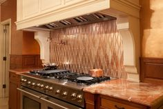Shimmering copper looks so luxurious in a kitchen and makes a great splashback option. Beautiful Kitchens loves this Treble glass mosaic design by De Ferranti.