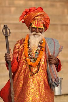 Holy man before the steps of Varanasi