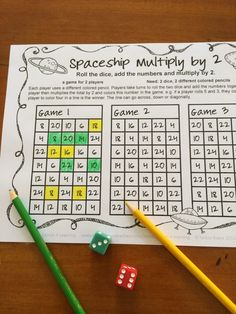 In Spaceship Multiply by 2, the players roll 2 dice, add the numbers and multiply the total by 2. They then color the answer. Play continues until one player creates a line of 4. $ The fun way to review multiplication facts! :)
