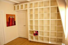 IKEA Hackers: Huge Expedit Wall...we're so doing this except building an area in the middle for a TV for our basement!