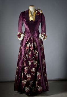 Dress of purple Atlas silk with a kind of satin and insertion of yellow satin. Made in Augusta Lundin, Stockholm. 1880's. Nordic Museum inv No 255,476th