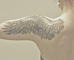 Done by Terhi at Pitbull, Oulu, Finland.  Angel wing tattoo.