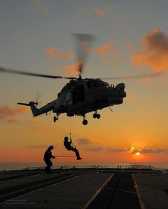 Lynx Helicopter Practicing Winching Drills Over HMS Argyll's Flight Deck by Defence Images, via Flickr