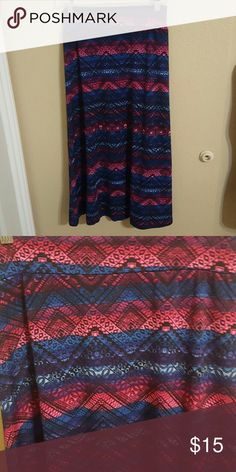 NWOT Super Cute Amy Byer Maxi Skirt size L (14) NWOT Never Worn Super Cute Amy Byer Maxi Skirt size L (14) pretty colors of pinks, blues, and black. Pretty Aztec Design. Perfect for back to school! Comfy stretchy pull on style. 95% Polyester 5% Spandex Amy Byer Bottoms Skirts