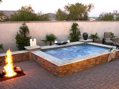 Submerged hot tub/spa with stone sitting wall.