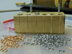 Tutorial Tuesday: So, this one's not about charm-making, BUT, I'm forever running out of the 'right size' jump rings and have been considering trying to make my own. I thought this guy's idea was A-MAZE-ING!!