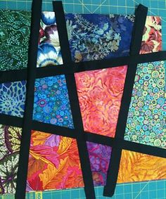 Stained Glass Stack and Slash--not really a tutorial, but it would make a great pillow or runner or quilt top if one were feeling mighty ambitious.  Love the look