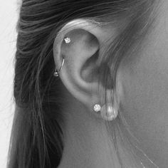 I don't like the big pearl, but this is the piercing placement I want. Maybe with the auricle a little further down though. I would also love a tragus piercing with a little tiny ring.