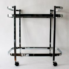 The first from our product line, this chrome mid century contemporary style bar cart seamlessly transitions into any space and with any decor. Bar Cart Styling, Mid Century Style, Contemporary Style, Wardrobe Rack, Chrome, Shopping, Furniture, Design, Home Decor