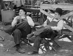 Laurel and Hardy taking a break at the set of Towed in A Hole, 1931...