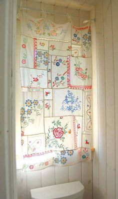 Vintage embroidered dresser scarves repurposed - I have a bunch of worn out pillowcases and doilies and scarves that might work here, or perhaps the tatted linen hankies?