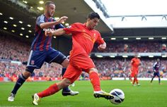 Stoke City s Northern Irish-born Irish defender Marc Wilson (L) vies with  Liverpool s Uruguayan striker Luis Suarez (R) during the English Premier  League ... 3ad298394f358