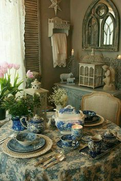 I looove the blue pattern...on the table settings & the tablecloth