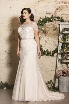 True Bride launches True Curves bridal collection | Curvy vintage bridal gown with capelet sleeves | bridemagazine.co.uk