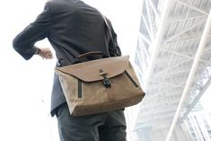 Staad Attaché bridges the gap between messenger bag and briefcase. Built-in padded pocket for the iPad Pro and Apple Pencil pocket and MacBook Pro Touch Bar.