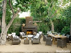 Outdoor Fireplace Designer Tobi Tobin completely revamped the backyard of her modern Hollywood Hills cottage. She used brick from an old patio for the new fireplace and created a terrace from sand mixed with granite. Outdoor Rooms, Outdoor Dining, Outdoor Gardens, Outdoor Furniture Sets, Outdoor Decor, Dining Table, Outdoor Seating, Furniture Ideas, Outdoor Lighting