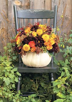 I'm not a huge fan of the fall colors in general, but I love the idea of the white (or painted) pumpkin filled with flowers that match the baby shower