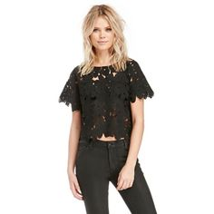 Black Floral Lace Drop Shoulder Crop Top Drink champagne in the Hamptons while wearing our Lace Drop Shoulder Top. This exotic blouse features a round neck, short sleeves, and a scalloped hem. Add a seamless bra for the perfect coverage. Complete your look with our matching skirt. Yes, please!  Length: 19 in. Bust: 36 in. Waist: 36 in. Sleeve length: 12 in. Measured from size small, please refer to size chart for more info Model Measurements: Height: 5'9 / Bust: 34A / Waist: 25 in. / Hip: 37…