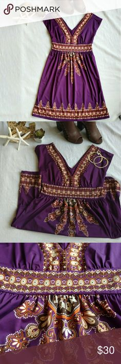 Purple Vneck Dress This dress is killer. Bold purple with orange and gold detail, small gold rhinestone embellishments. Low Vneck front and back. Fitted waist, flowy bottom. Excellent condition - worn once! Dresses Midi