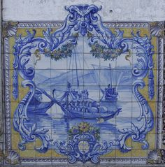 An azulejos panel depicting two rabelos (Douro boats) transporting barrels of Port on the Douro. Mondim de Basto station, Portugal.