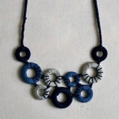 washers wrapped in embroidery floss and made into a necklace