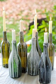 Multi-purpose your wine bottles as candle holders! {use them on your porch or for an outdoor soiree} // LuckyMag.com