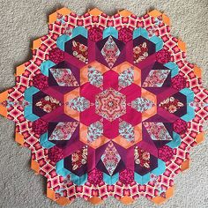 https://flic.kr/p/rjFJ3R   Finished Rosette #1 of Millefiore quilt. Whew!  That took a long time to piece that last round and to attach it. Now to choose fabric for Rosette #2.  #thenewhexagon #thenewhexagonmillefiorequiltalong