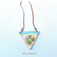 Succulent arrangement on the triangle frame polymer necklace