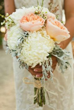 Wedding bouquet features white china mums and dusty miller