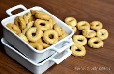 Taralli al vino bianco; a hard biscuit-type of specialty from Campania and other southern areas of Italy, generally boiled then baked, and used for dunking in wine. My nonna made a sugar-frosted version which was my favorite treat at Easter, but you also find it made with pepper.