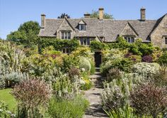 The Cotswolds district is famous for having picturesque architecture and landscapes. This classic English garden, where plants appear to grow freely (but are actually thoughtfully planned out), is from a private home in Chipping Campden.   - HouseBeautiful.com