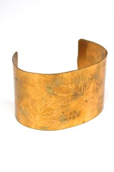 "Handcrafted from brass, this cuff bracelet features leaf prints and the words ""Be Wild.""   Be Wild Cuff by Christina Sin. Accessories - Jewelry - Bracelets North Carolina"