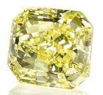 An unmounted rectangular-cut Fancy Vivid Yellow diamond weighing 70.19cts, VS2.