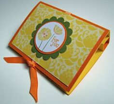Qbee's Quest: Lip Balm Holder.  This site has step by step pictures & tutorial.