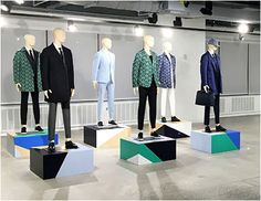 Presentation pedestals need not be the commonplace vertical rectangles and elongated cubes. Hugo Boss® goes to extremes in support of two merchandise lines, ranging from unusual geometric pedestals...