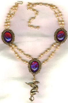 Two strand pearl necklace, tudor, three broaches, cabochons in ruby. Renaissance Style