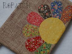 I like this idea for showcasing vintage fabric on the front of a small clutch with an earth toned fabric as the background.