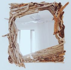 Driftwood mirror with shell decoration