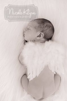 Newborn with angel wings - NJ Newborn Photography - www.nicoleklym.com