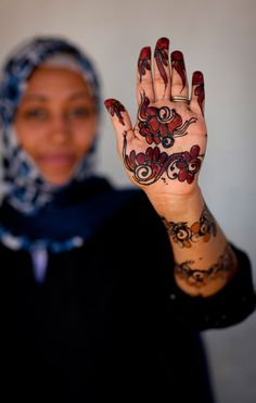 Africa   A woman from Lamu (Kenya) shows off her henna designs on her hands   © Eric Lafforgue