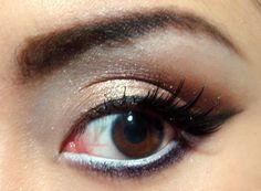 White eyeliner to make your eyes look bigger.